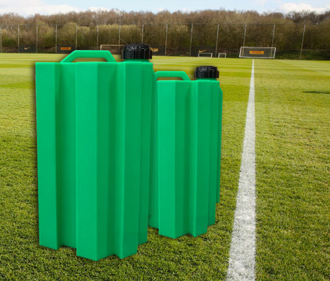 grass pitch with paint drums on